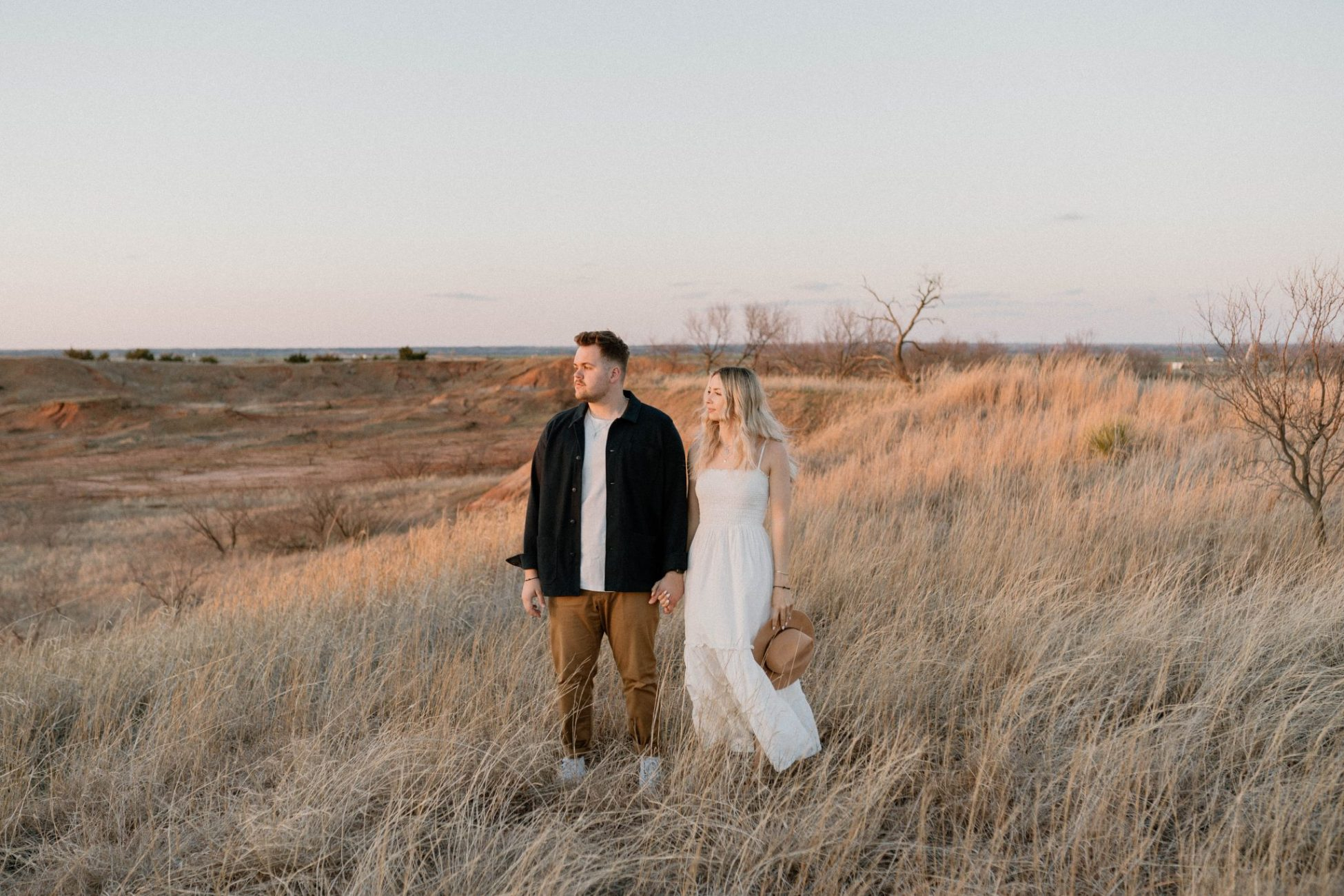Couple Standing in a field at Gloss Mountains during golden hour